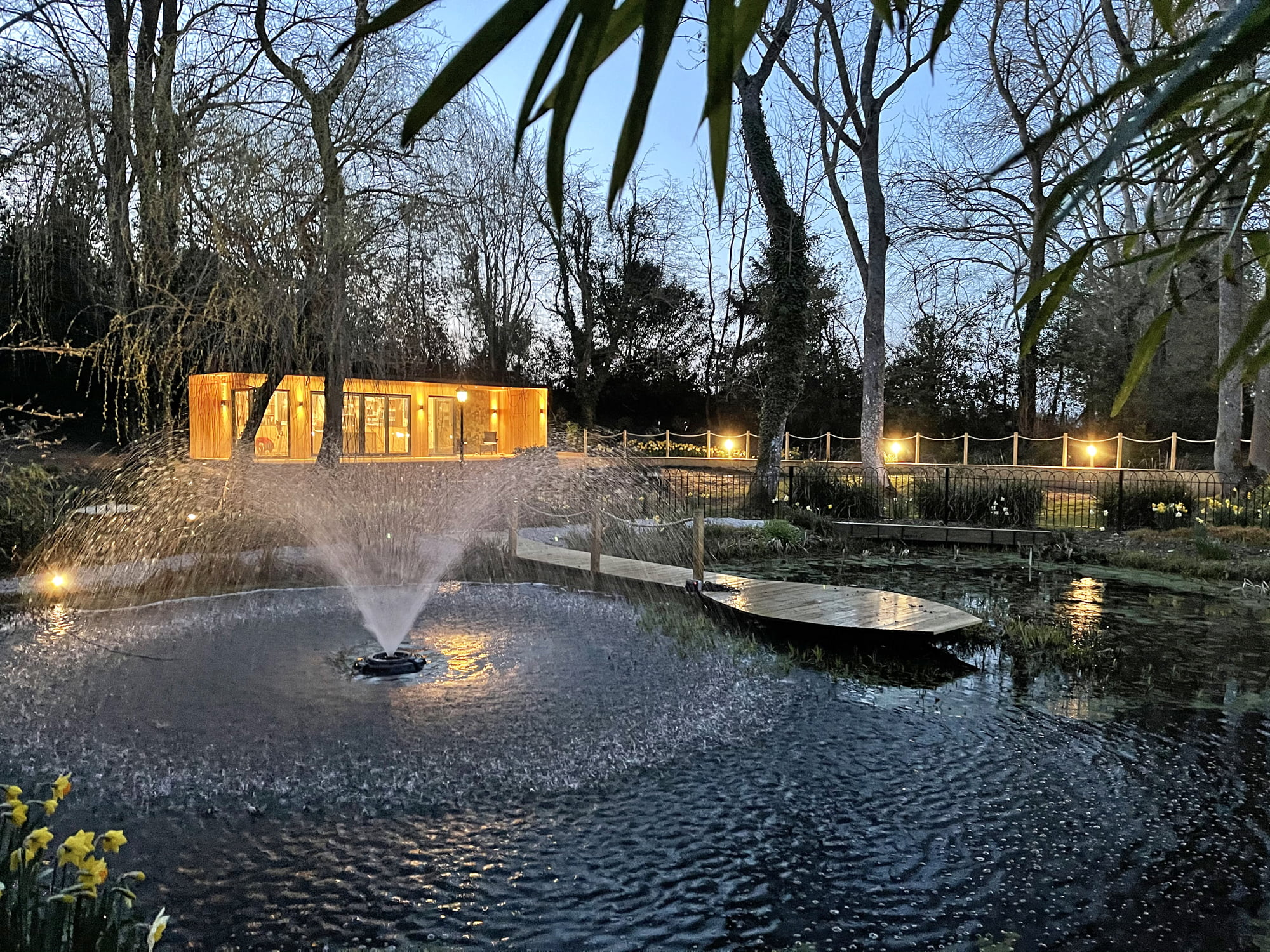 Garden office by pond fountain